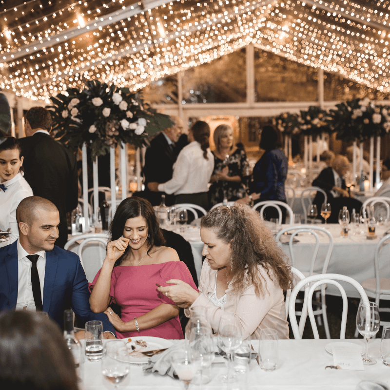 guests sitting and chatting at a wedding