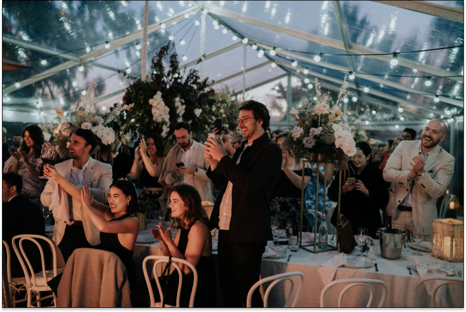 people applauding at a wedding